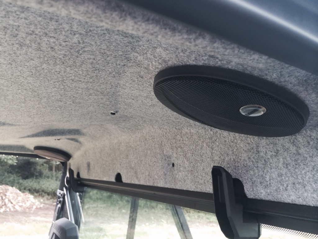 Twin speakers neatly installed in roof lining